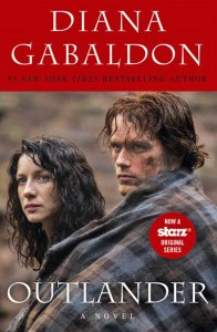 The new Outlander cover, featuring the stars of the TV series that debuted on Starz in 2014.
